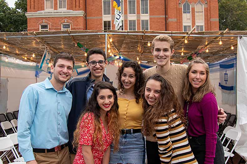 Students celebrate Shabbat in front of Seney Hall.