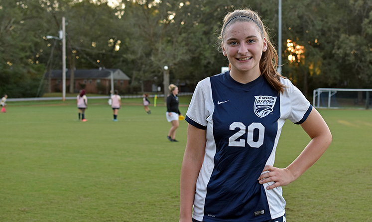 Annie Chappell wears the No. 20 jersey, the same as her dad's baseball number at Emory.