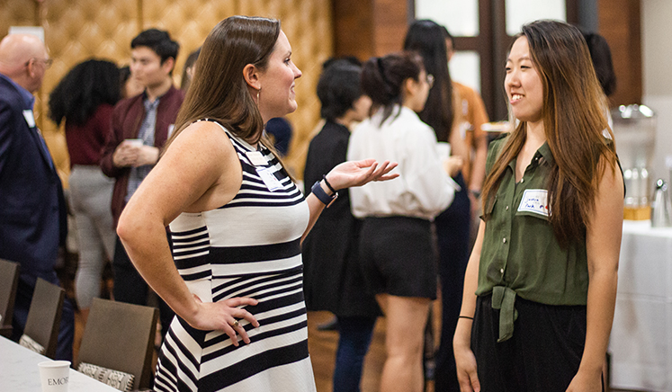 Oxford alumna Kinsey McMurtry talks with second-year student Jessica Park during a recent networking event.
