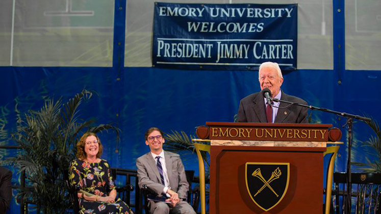 Three presidents, one stage: Emory President Claire E. Sterk and Student Government Association President Ben Palmer join U.S. President Jimmy Carter on the Town Hall stage.