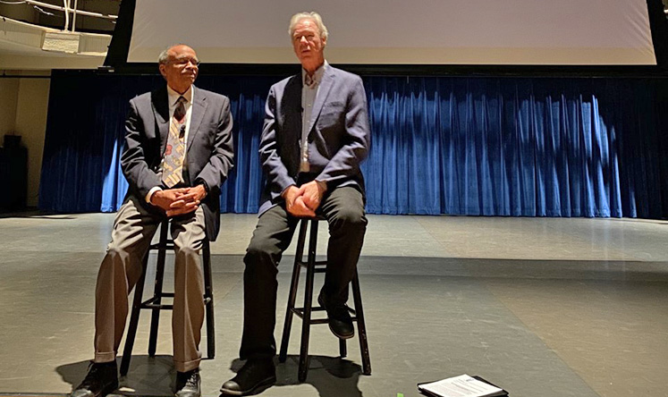 Left, Luther E. Smith Jr., Emory Candler School of Theology Professor Emeritus of Church and Community, and filmmaker Martin Doblmeier talk about the film 'Backs Against the Wall: The Howard Thurman Story' after the screening at Williams Hall.