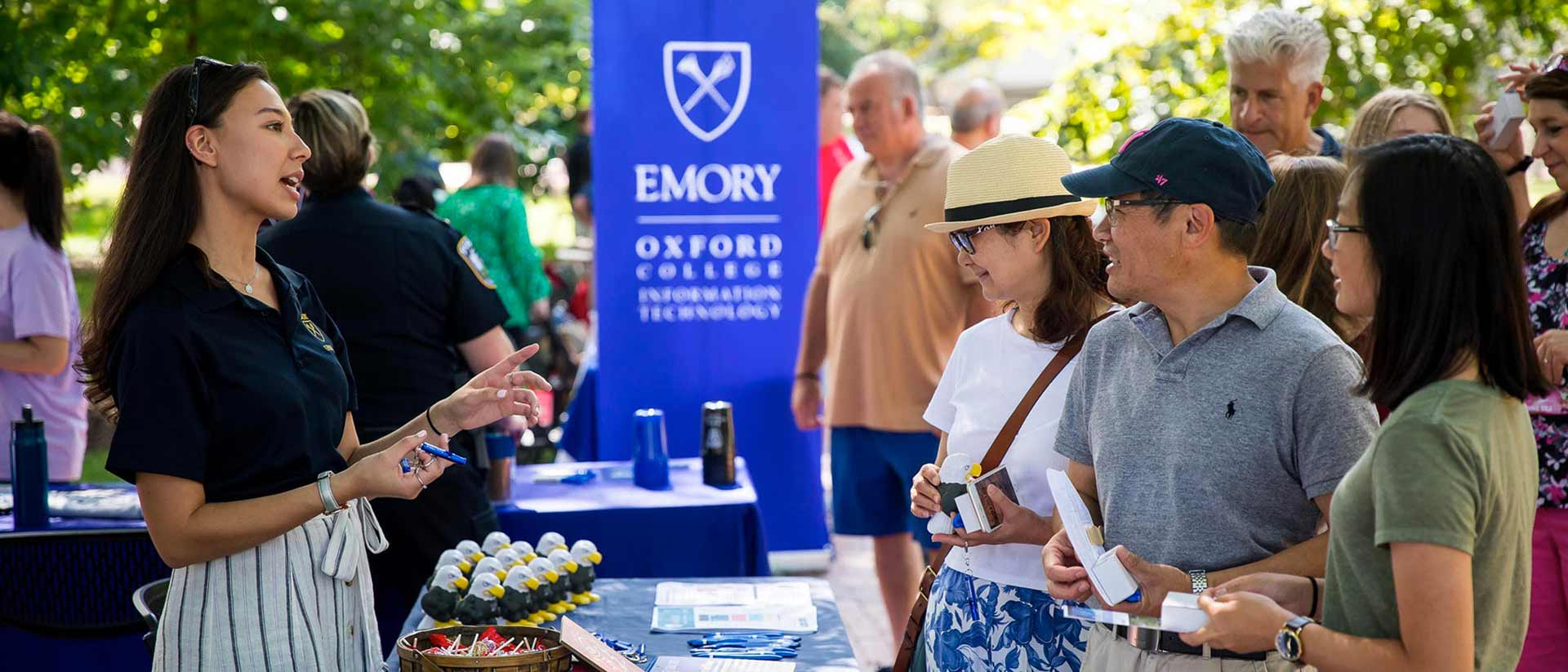 Parents engage with information at Oxford orientation.